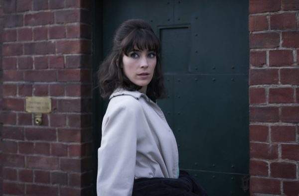 Peregrine Fisher at the door to the Adventuresses Club in Ms. Fisher's Modern Murder Mysteries